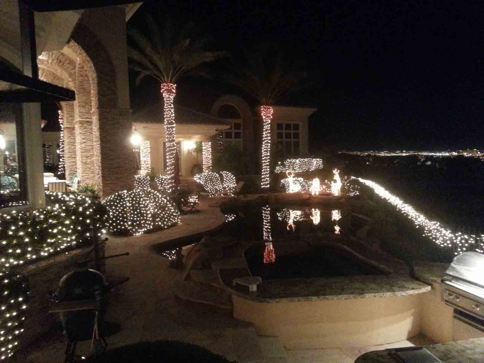 Backyard Christmas lights by Holiday Decorations in Las Vegas